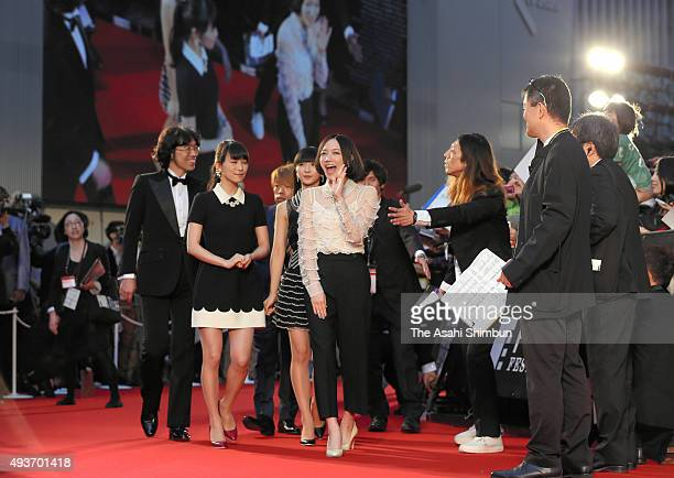 Members of music group Perfume walk on the red carpet during the opening ceremony of the Tokyo International Film Festival at Roppongi Hills on...
