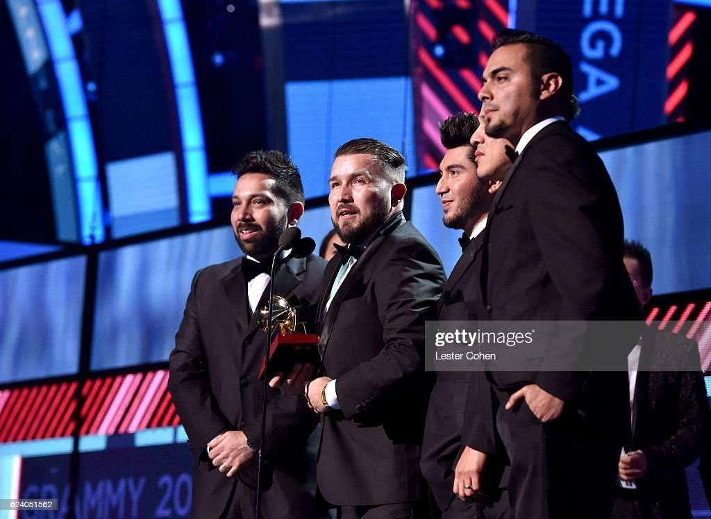Members of musical group Banda El Recodo accept Best Banda Album for 'Raices' onstage during The 17th Annual Latin Grammy Awards at T-Mobile Arena on November 17, 2016 in Las Vegas, Nevada.