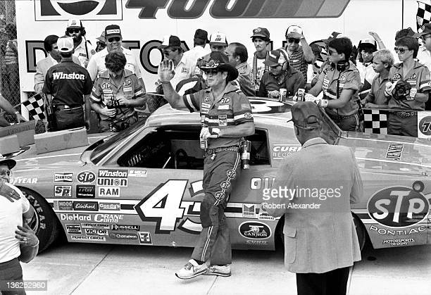 Members of NASCAR driver Richard Petty's racing team including his crew chief Buddy Parrott wait for Petty to arrive in Victory Lane at the Daytona...
