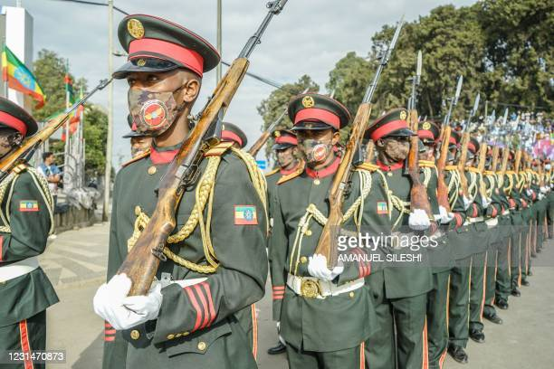 Members of National Defence Force stands on guard during the celebration of the 125th victory of Adwa, at Menelik square in Addis Ababa, Ethiopia, on...