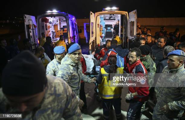 Members of National Medical Rescue Team carry an injured Somalian on a stretcher as funerals of two Turkish people, who lost their lives in an...