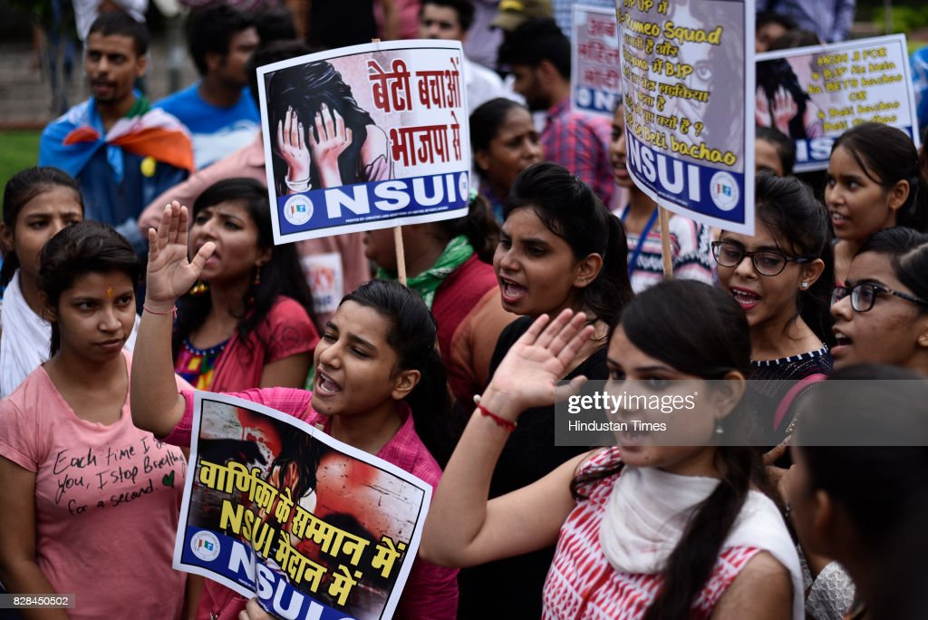 Members of National Students Union Of India hold placards as they protest against Vikas Barala a BJP leader`s son accused of stalking a woman in...