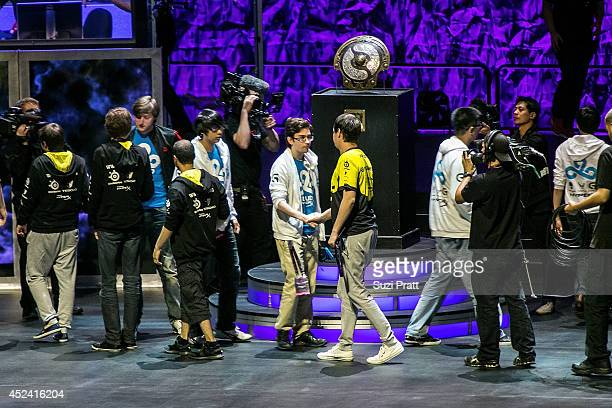 Members of Natus Vincere and Cloud 9 shake hands following the end of a match at The International DOTA 2 Championships at Key Arena on July 19 2014...