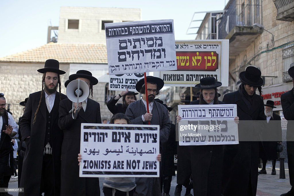 Members of Neturei Karta, a fringe ultra-Orthodox movement within the anti-Zionist bloc, take part in a protest against Israel's parliamentary election in Jerusalem's Mea Shearim neighbourhood on January 22, 2013 in Jerusalem, Israel. Israel's general election voting has begun today as polls show Netanyahu is expected to return to office with a narrow majority.