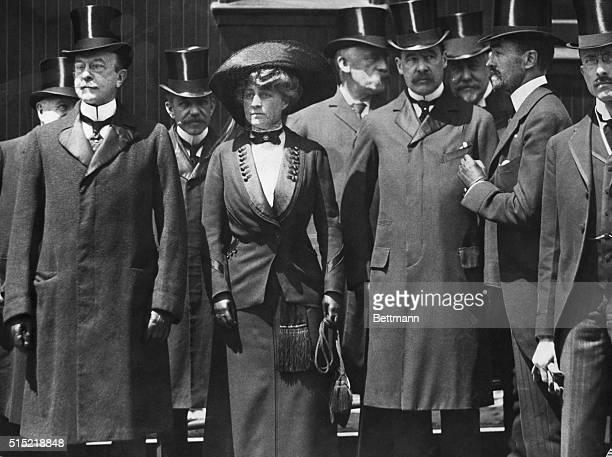 Members of New York high society, from left to right John S. Milburn, Mrs. Cornelius Vanderbilt III, Stuyvesant Fish, James Roosevelt Roosevelt, and...
