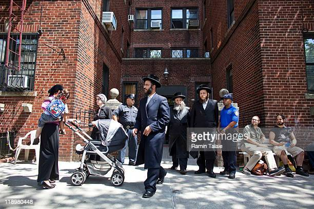 Members of New York Police Department and media wait in front of the residence of Leibby Kletzky a murdered eightyearold boy who went missing from...