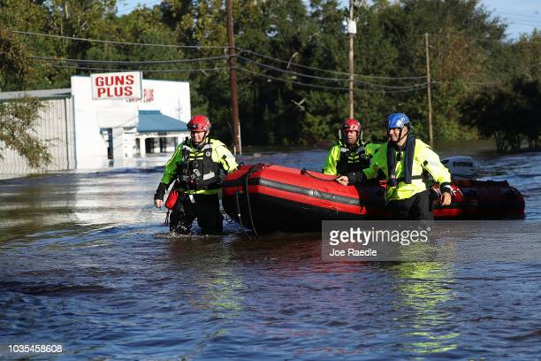 Members of New York Urban Search and Rescue Task Force One work in an area flooded with waters from the Little River as it crests from the rains...