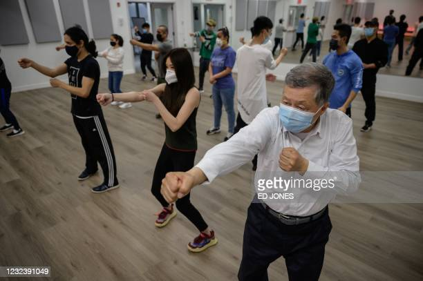Members of New York's Asian American community attend a self-defense class organized by the Public Safety Patrol, a civil patrol team started in...