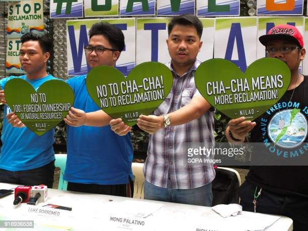 Members of NILAD an organization holding a cut out heart shape placard clamoring against charter change and reclamation The Green groups NILAD and...