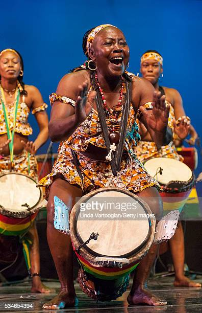 Members of Nimbaya the Women's Drum and Dance Company of Guinea plays djembe drums as they perform during the group's New York City debut in a World...
