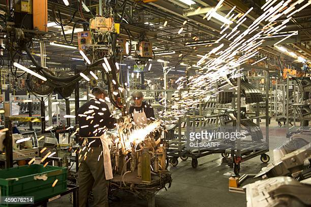 Members of Nissan's manufacturing staff weld vehicle panels in the Body Shop in their Sunderland Plant in Sunderland North East England on November...