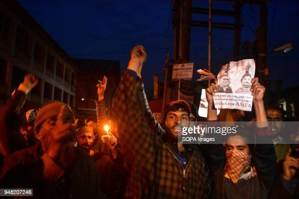 Members of nomadic Gujjar community shout slogans during a night protest against the rape and murder of an eightyearold girl in Srinagar Indian...