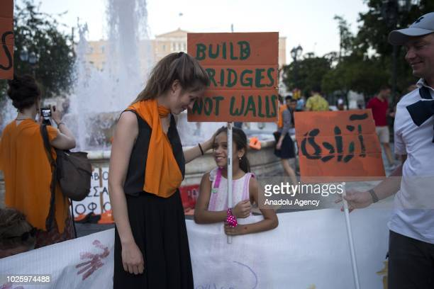 Members of non governmental organizations stage a demonstration against the policies of Italy and European Union towards some groups which try to...