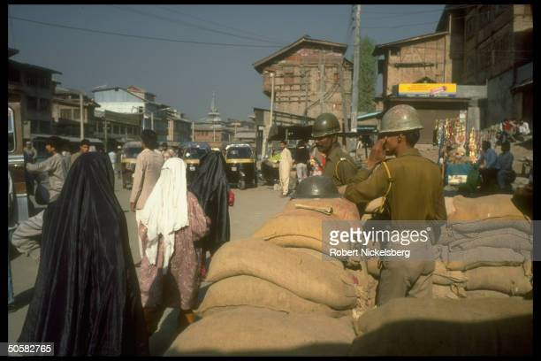 Members of nonKashmiri CRPF Central Reserve Police Force behind sandbags re problems w Kashmiri separatist movement