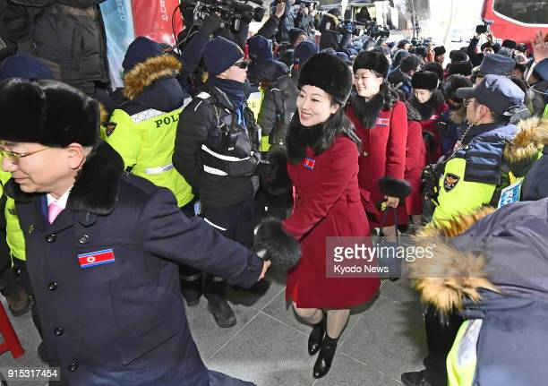 Members of North Korean cheerleading and taekwondo demonstration squads wave when they arrive at a hotel in Inje South Korea on Feb 7 for the...