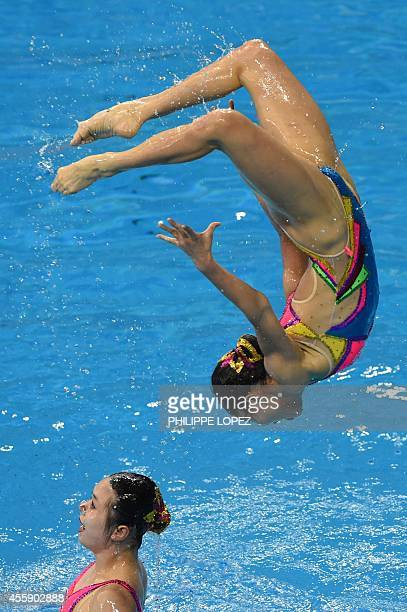 Members of North Korea's team execute a jump in the team free routine final synchronised swimming event during the 2014 Asian Games at the Munhak...