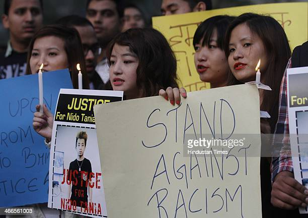 Members of NorthEastern state of India during a candle light vigil against racism and the beating and killing of student Nido Taniam at Jantar Mantar...