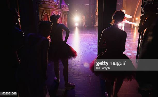 Members of Northern Ballet stand in the wings and watch a performance by dancer Sean Bates as he dances the role of the Cavalier during a performance...