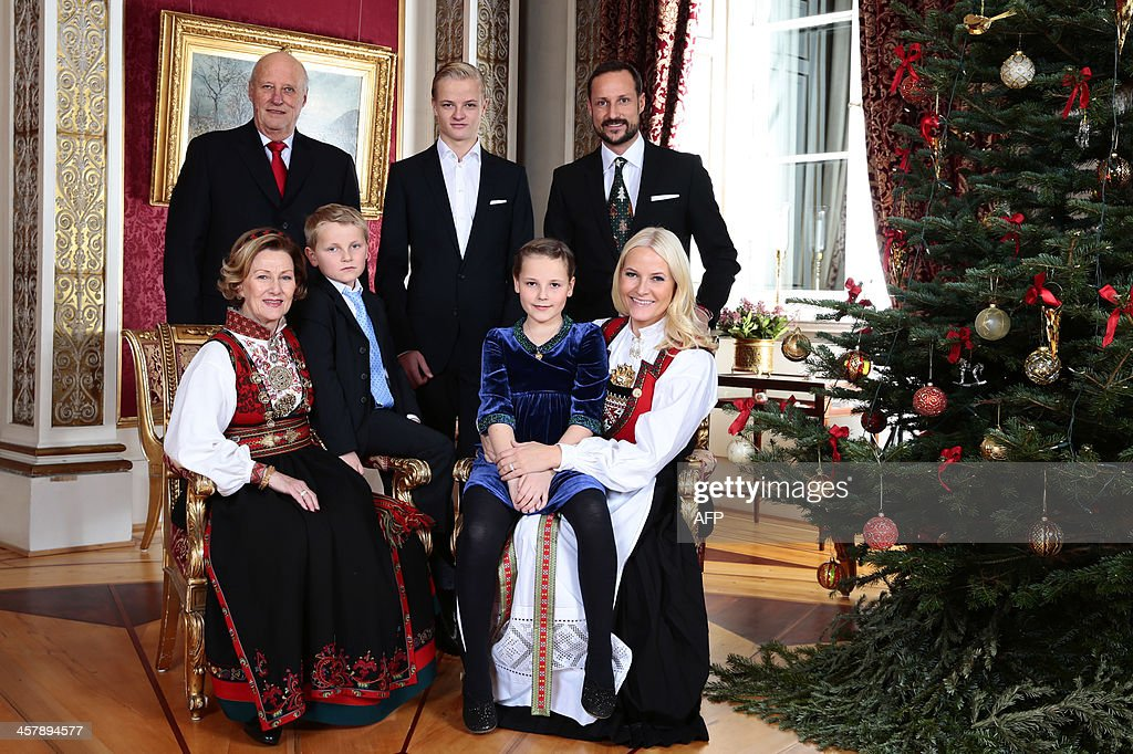Members of Norway's royal family (L-R) King Harald, Queen Sonja, Prince Sverre Magnus, Marius Borg Hoiby, Princess Ingrid Alexandra, Crown Prince Haakon and Crown Princess Mette-Marit pose at the Christmas family photo session at the Royal Castle in Oslo, on December 19, 2013. AFP Photo / NTB scanpix / POOL/ Haakon Mosvold Larsen