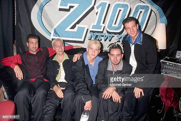 Members of N'Sync pose together backstage at Z100's ZDay New York City's 100th Birthday Blast