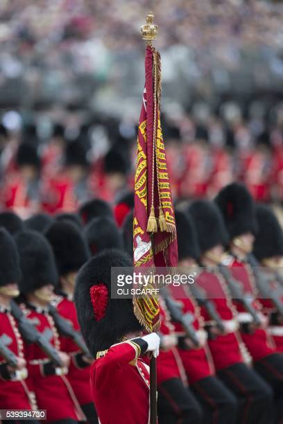 Members of Number 7 Company Coldstream Guards troop the Queen's Colour during the Queen's Birthday Parade 'Trooping the Colour' in London on June 11...
