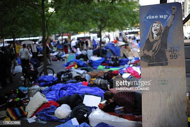 Members of Occupy Wall Street sleep, spending the night on Zuccotti Park near Wall Street in New York, October 11, 2011. Protesters from the Occupy...