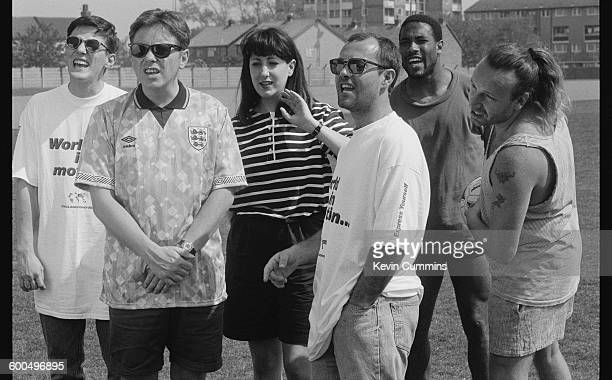 Members of of English rock group New Order with comedian Keith Allen and footballer John Barnes after they recorded the official song of the England...