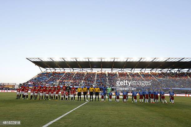 Members of of Manchester United and the San Jose Earthquakes stand on the field before their International Champions Cup match on July 21 2015 at...