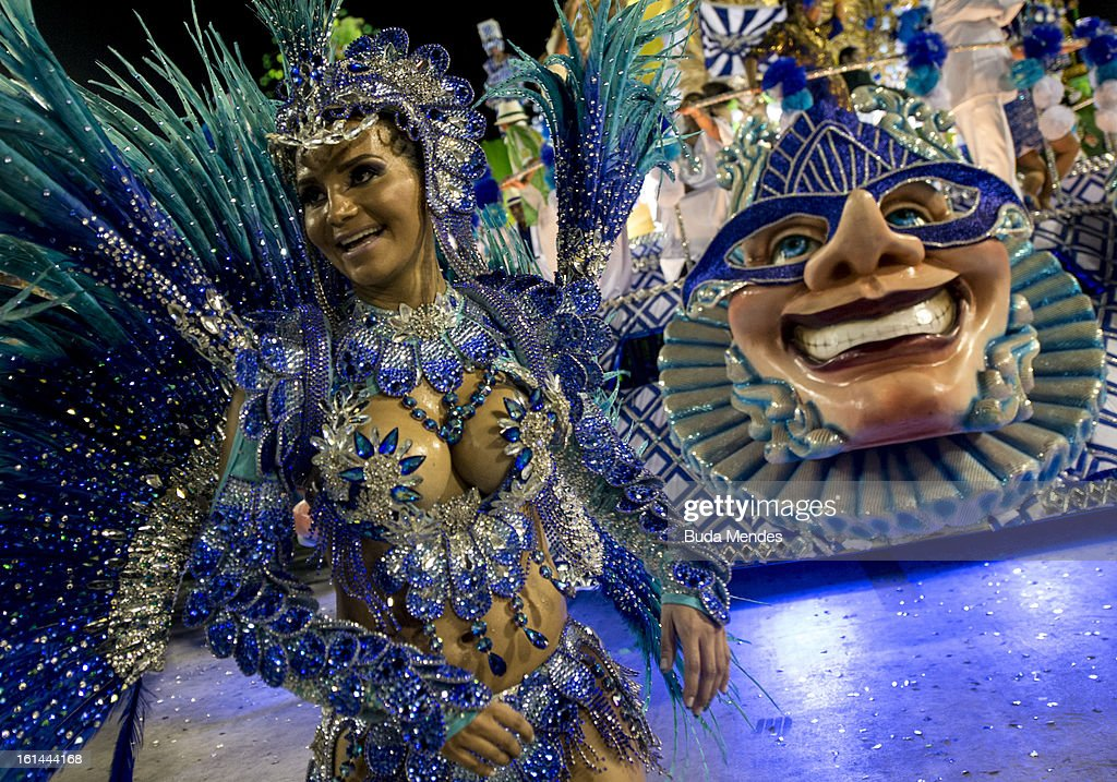 Members of of Portela Samba School during the closing parade of the day at 2013 Brazilian Carnival at Sapucaí Smbodrome on February 11; 2013 in Rio de Janeiro; Brazil. Rio's two nights of Carnival parades began on February 10 in a burst of fireworks and to the cheers of thousands of turists and locals who have previously enjoyed Street celebrations (known as Blocos de rua) all around the city.