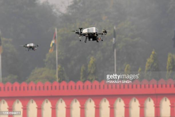 Members of offensive swarm drone system fly drones to demonstrate skills during a ceremony to celebrate India's 73rd Army Day in New Delhi on January...