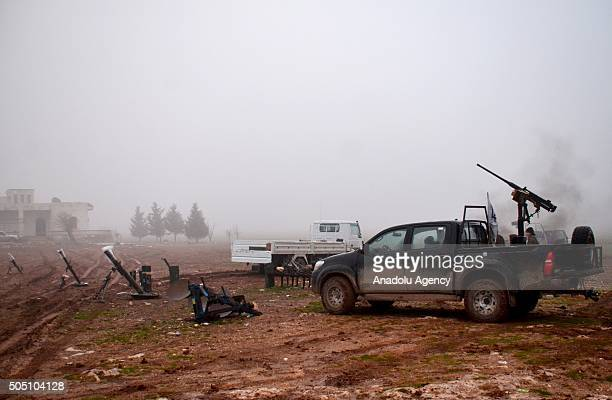 Members of opponent Sultan Murad and Mutasim Brigades attack Daesh with howitzers at Kazal village in Aleppo Syria on January 15 2016