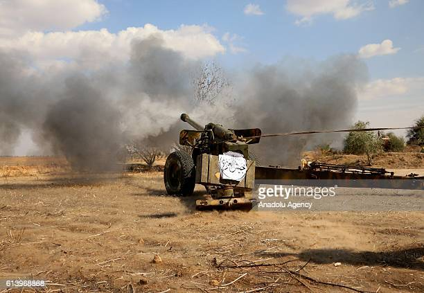 Members of opposition groups attack with a tank to Assad Regime Forces at Kawkab district of Hama Syria on October 11 2016