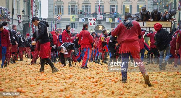 Members of orange battle teams take part in the traditional 'battle of the oranges' held during the Ivrea Carnival on February 7 2016 in Ivrea near...