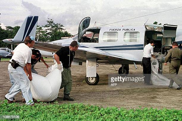 Members of Organisation of Judicial Investigation transfer one of the 10 bodies of victims from the plane crash 28 August 2000 The small plane...