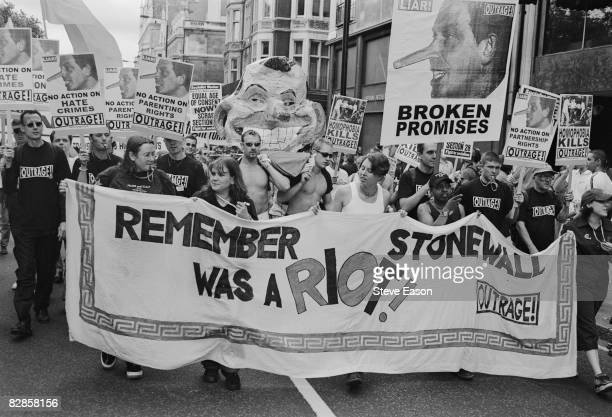 Members of Outrage carry pictures of Tony Blair with the title 'Broken Promises' at the Gay Pride Mardi Gras parade in London 3rd July 1999