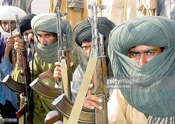 Members of Pakistani Marri Baloch tribe armed with AK47 rifles listen to their leader at a camp in Kahan some 250 kilometers southeast of Quetta the...