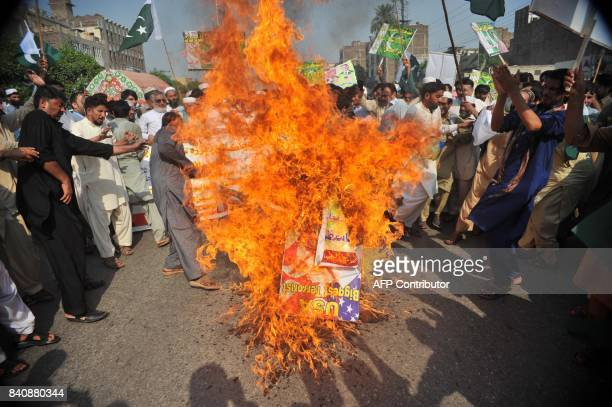 Members of Pakistani traders union burn posters of US President Donald Trump in a protest in Peshawar on August 30 2017 Pakistani National Assembly...
