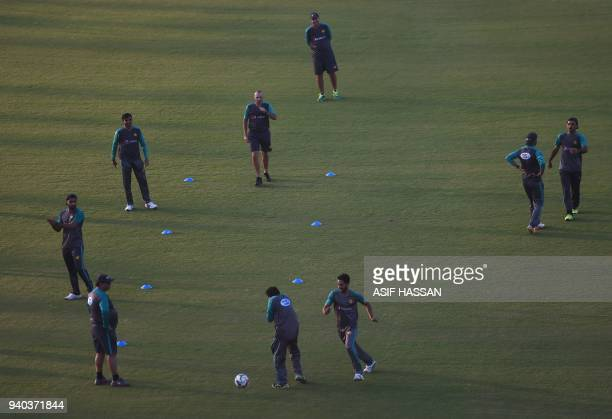 Members of Pakistan's cricket team play football during a team practice at the National Cricket Stadium in Karachi on March 31 on the eve of their...
