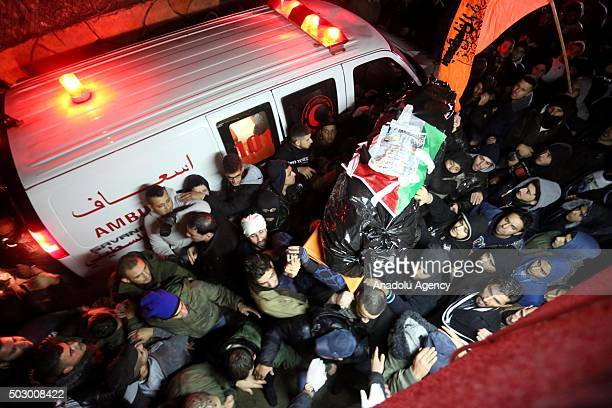 Members of Palestine Red Crescent carry the bodies of 7 Palestinians who has been killed by Israeli soldiers to ambulance in Ramallah West Bank on...