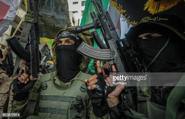 Members of Palestinian groups' armed wings march during a parade organized to show their solidarity with the resistance against Israel's restrictions...