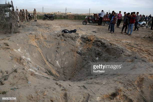 Members of Palestinian Hamas security forces survey the scene of an explosion in the northern Gaza Strip December 12 2017 Two Palestinians were...