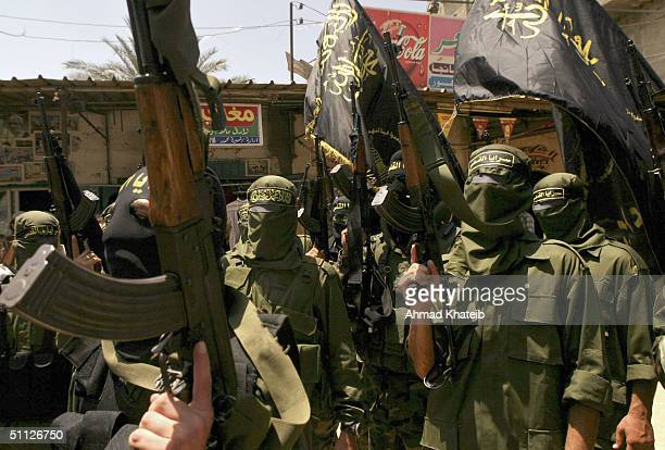 Members of Palestinian militant group Islamic Jihad are seen during the funeral of Palestinian militant Mohamed Odwan on July 29 in Rafah refugee...