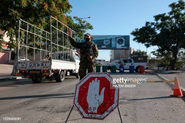 Members of Palestinian security forces man a checkpoint in Bethlehem on June 29 as a decision to close the city for 48 hours as of 6.00am takes...
