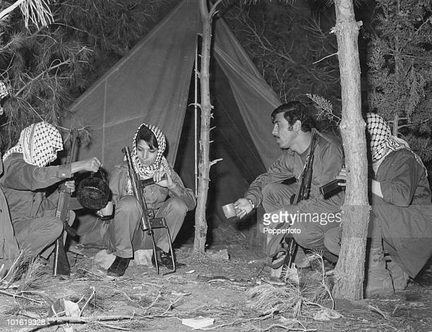 Members of Palestinian terrorist group the Popular Front for the Liberation of Palestine drinking tea during a training excercise circa 1969 Among...