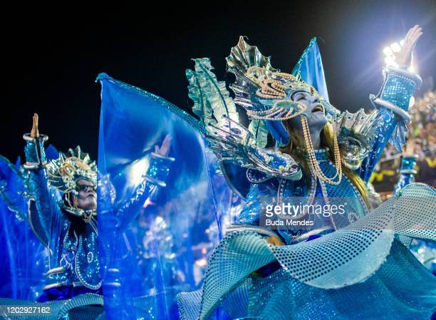 Members of Paraiso do Tuiuti samba school perform during the first night of 2020 Rio's Carnival Parades at the Sapucai Sambadrome on February 23 2020...
