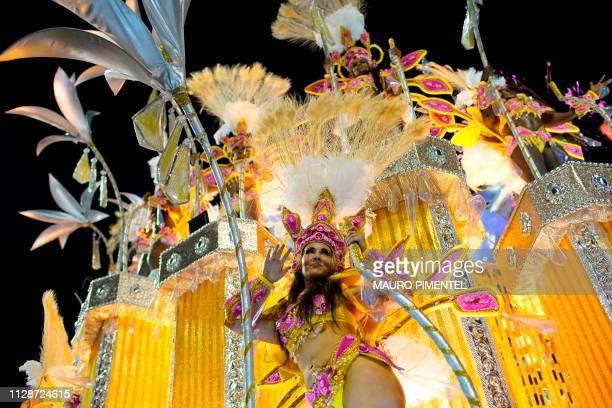 Members of Paraiso do Tuiuti samba school perform during the second night of Rio's Carnival parade at the Sambadrome in Rio de Janeiro Brazil on...