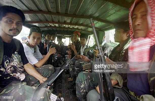 Members of paramilitary group aboard a vehicle May 2 2000 in Talipao Sulu The paramilitary are trying to prevent the escape of members of Abu Sayyaf...