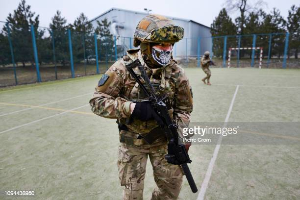 Members of paramilitary group Azov Battalion are training in a base, a former holiday resort near Mariupol as the Azov batallion re-join the...