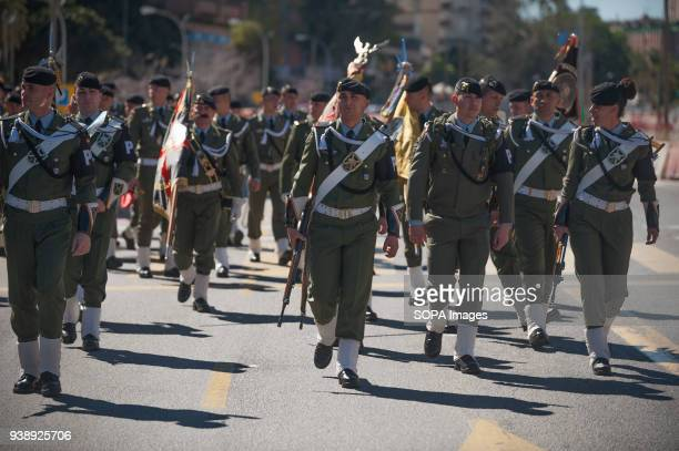 Members of paratrooper brigade from the air force are seen walking on the street before to perform in a parade as part of Holy Week in Malaga The...