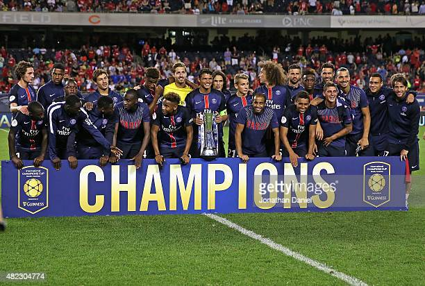 Members of Paris SaintGermain celebrate with the Champions Cup after a match against Manchester United in the 2015 International Champions Cup at...